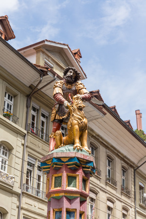 lore: slaying the lion, 16th century traditional colourful fountains & statues in the old city of Bern, Switzerland