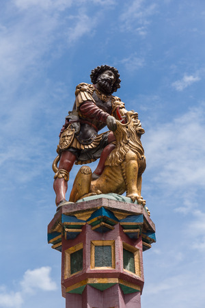 slaying: slaying the lion, 16th century traditional colourful fountains & statues in the old city of Bern, Switzerland