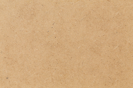 paper: Pressed beige chipboard texture. Wooden background