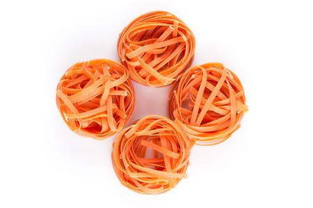 fettuccine: chilli orange fettuccine pasta on white background