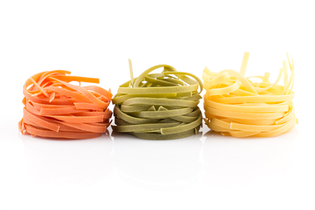 pasta isolated: three colour roll nest pasta on a white background Stock Photo