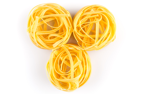 fettuccine: Fettuccine pasta nest isolated on white background