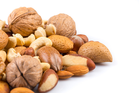 Variety of Mixed Nuts Isolated on White Background Stock Photo
