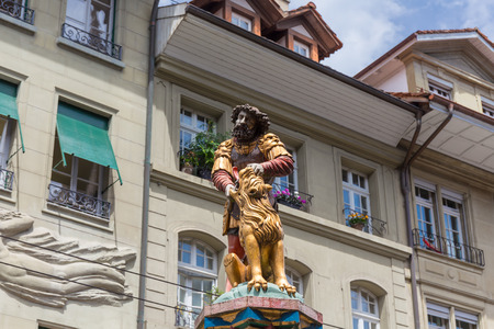 slaying the lion, 16th century traditional colourful fountains & statues in the old city of Bern, Switzerland