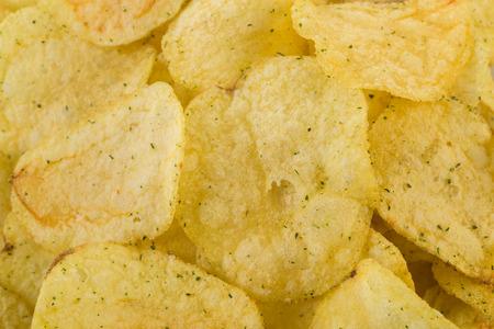 prepared potato: Prepared potato chips snack closeup viewas a background Stock Photo