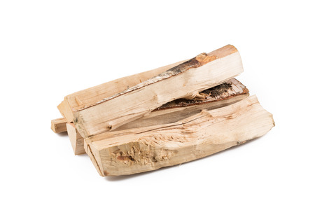kindling: Stack of cut logs firewood from silver birch tree isolated on white background