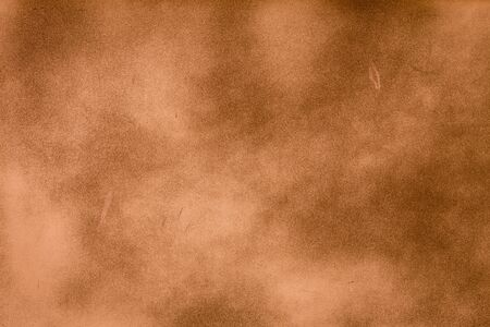 bright center: Brown dark texture background with bright center spotlight