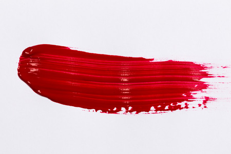 Red stroke of the paint brush on white paper Archivio Fotografico