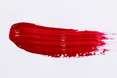 Red stroke of the paint brush on white paper Standard-Bild