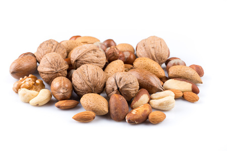 Variety of Mixed Nuts Isolated on White Background Imagens