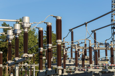 megawatt: Electric substation tower for generating energy with sky background Stock Photo