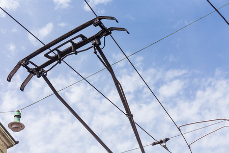 conjoin: trolley trolleybus electricity cable construction on sky background Stock Photo
