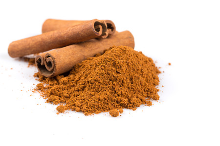 wood stick: cinnamon sticks with powder isolated on white background