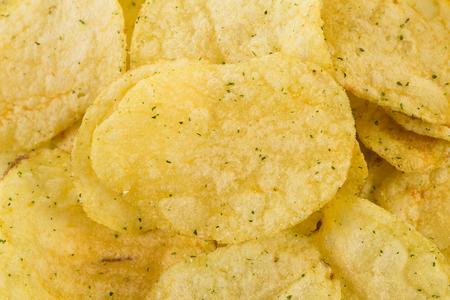prepared: Prepared potato chips snack closeup view as a background Stock Photo