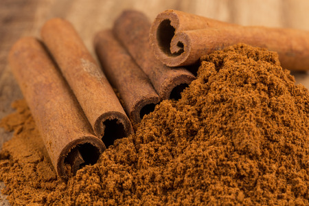 cinnamon: Cinnamon sticks with cinnamon powder Stock Photo