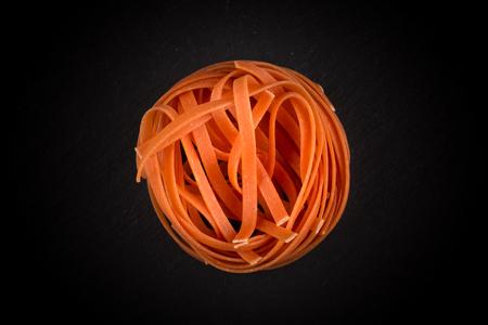 fettuccine: chilli orange fettuccine pasta on dark background
