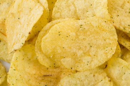 prepared potato: Prepared potato chips snack closeup view as a background Stock Photo