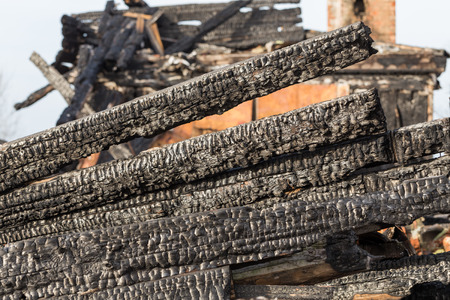 ruinous: The charred ruins and remains of a burned down house Stock Photo