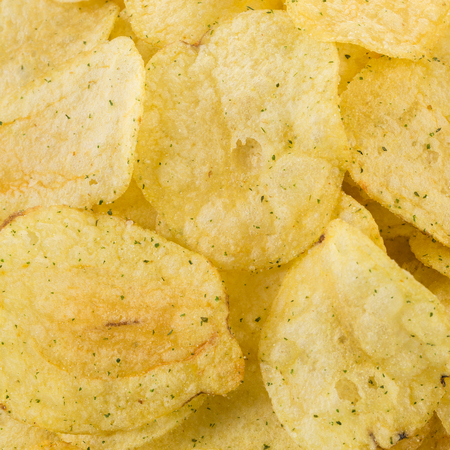 titbits: Prepared potato chips snack closeup view as a background Stock Photo