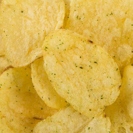 serrate: Potato chips background Stock Photo