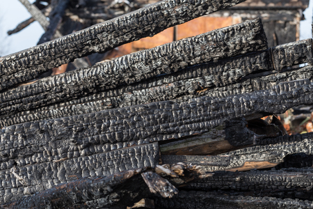 charred: The charred ruins and remains of a burned down house Stock Photo