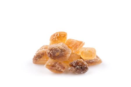 caramelized: Brown caramelized lump cane sugar cube isolated on white background