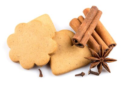 star anise christmas: Gingerbread hearts cookies on white background. Christmas decoration