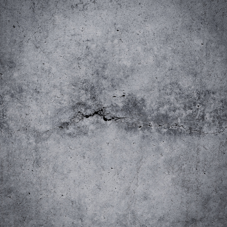 Grungy cracked concrete wall and floor as background texture
