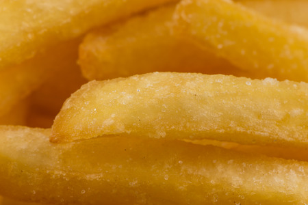 fatty food: Fried french fry potatoes closeup for background Stock Photo