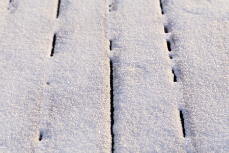 perpendicular: Snow covered wood terrace floor background texture
