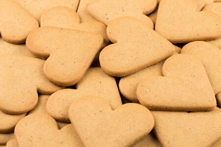 gingerbread cookies: Gingerbread hearts cookies as a background. Christmas decoration. Stock Photo