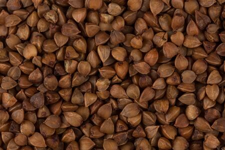 caloric: Buckwheat texture high-quality photograph of premium buckwheat seeds
