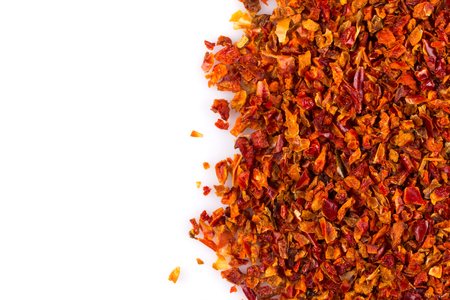 crushed: Crushed red chili pepper on white background