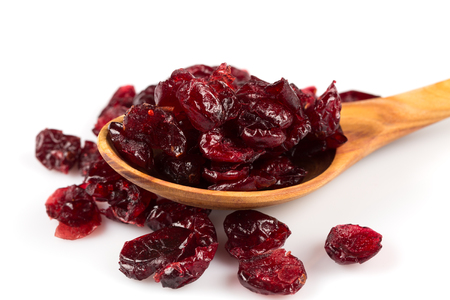 Pieces of dried cranberries isolated on white background
