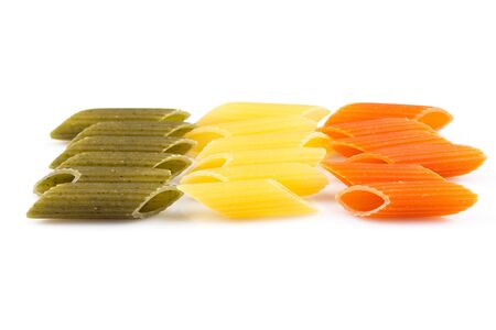 tri  color: Raw colored pasta isolated on white background. Tomato, spinach and wheat Stock Photo