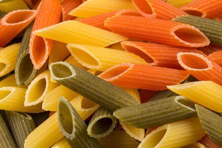 tri  color: Color penne pasta. Tomato, spinach and wheat pastas in horizontal format Stock Photo