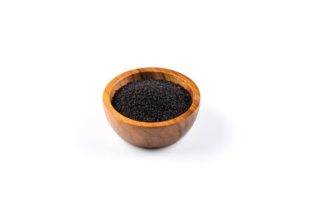 black seeds: Sesame black seeds in wooden bowl isolated on white background Stock Photo