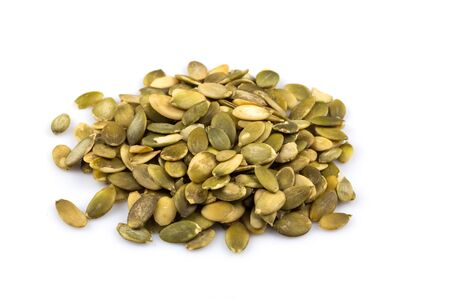 Heap of raw pumpkin seeds isolated on white background Stock Photo