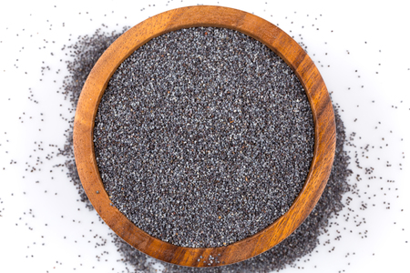 poppy seeds: poppy seeds in a wooden bowl on a white background