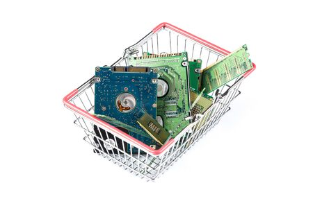 figurative: shopping trolley filled with computer stuff on white background