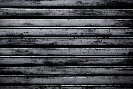 shutter door: metal roller shutter door dark texture background