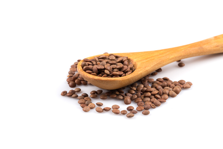 Organic lentils in spoon Isolated on a white background - close up shot Standard-Bild