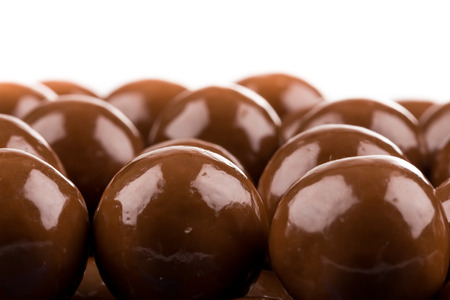 multiple: Multiple chocolate ball candies composition, isolated over the white background