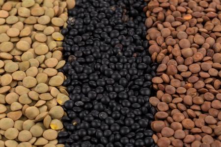 leguminosas: Mezcla de diversas legumbres lentejas de color para el fondo Foto de archivo