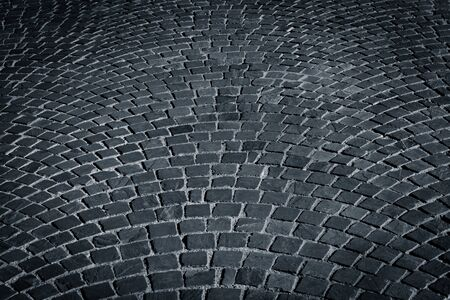 cobblestone road: patterned paving tiles cobblestone road for texture