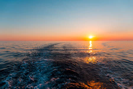 trace: Sunset in the sea and a trace