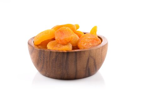 light and shadow: Dried apricots on white background with a light shadow Stock Photo