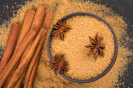 christmas scent: star anise and cinnamon on a background of the tropical brown sugar