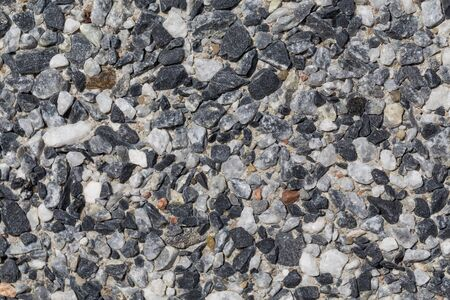 small stones: Small stones wall used for background texture Stock Photo