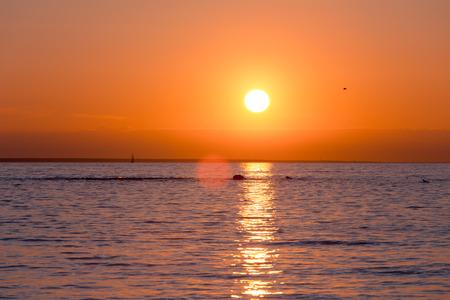 sunset beach: Bright sky and water at sunset over Baltic sea of Tallinn, Estonia